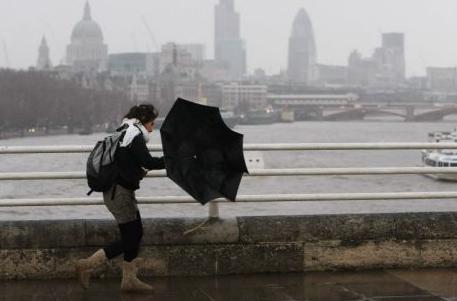 Woman fighting umbrella